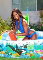 Ebony babe strip in the backyard
