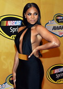 Ashanti in a sexy dress