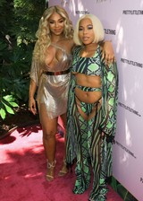 Ashanti showing cleavage