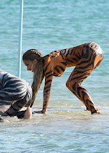 Cardi B tiger body paint