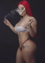 Big booty babe smoking weed