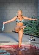Coco doing the splits in a bikini