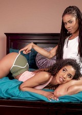 Two black babes strip together