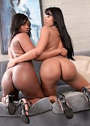 Two black porn star showing ass together