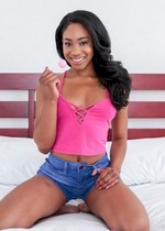 Ebony girl gets naked on a bed