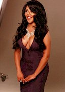 Lil Kim in a tight dress with cleavage