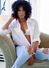 Ebony babe strips