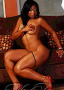 Ms Juicci naked on the sofa