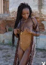 Ebony babe posing nude