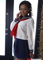 Ebony girl in a school uniform
