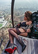 Sexy babe in a helicopter